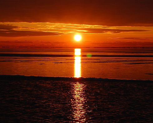 sunrise-over-frozen-bay